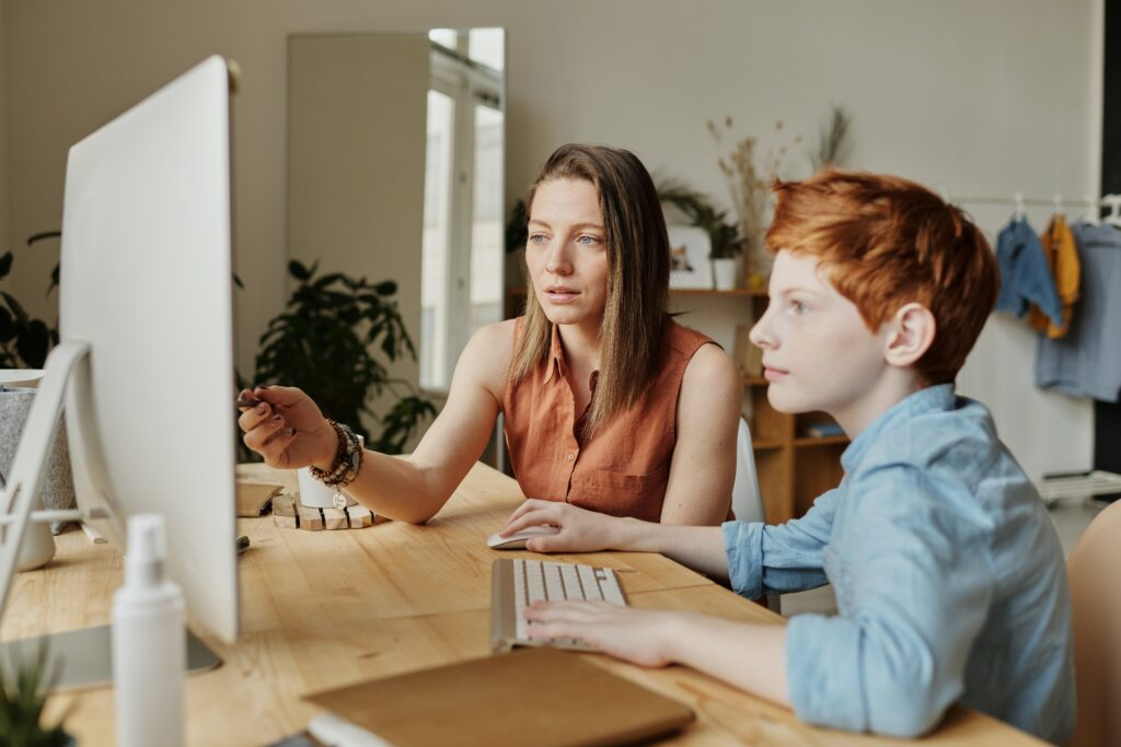 mother assisting son with academics